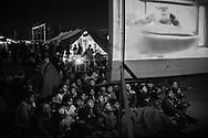 16 April 2016, Greece, Idomeni. Kids during the screening of a cartoon movie in the refugee camp of Idomeni.