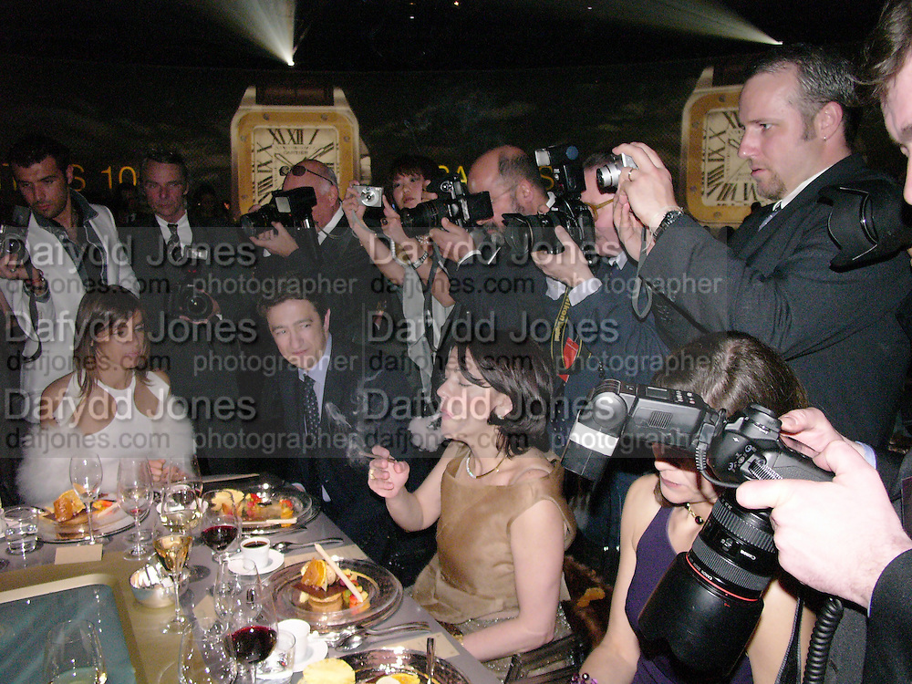 Carine Roitfeld, Party to celebrate 100 years of the Santos  de Cartier watch. Le Bourget airport. Paris. 7 April 2004. ONE TIME USE ONLY - DO NOT ARCHIVE  © Copyright Photograph by Dafydd Jones 66 Stockwell Park Rd. London SW9 0DA Tel 020 7733 0108 www.dafjones.com