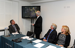 Former chief whip Andrew Mitchell (3rd from left) watches the CCTV footage from Downing Street during a press conference in Farringdon to give his reaction on the Crown Prosecution Service's decision on the 'Plebgate' row, accompanied by his wife, Dr Sharon Bennett (right),  David Davies MP and Stephen Parkinson.  Tuesday, 26th November 2013. Picture by Ben Stevens / i-Images