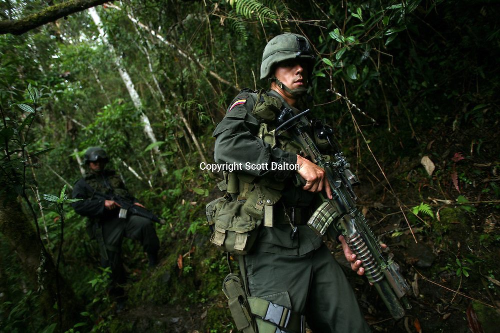 Members of Jungla, a unit of the Colombian anti-narcotics police, patrol while they are searching for a cocaine lab in a remote part of Cundinamarca state in central Colombia, on June 29, 2007. (Photo/Scott Dalton)