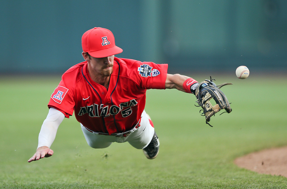 OMAHA -- 6/22/2015: Arizona shortstop Louis Boyd (5) tries for a ground ball hit by UCSB's Kyle Plantier (22) in the top of the fifth. Plantier got a single. Arizona played UCSB in Game Nine at the College World Series at TD Ameritrade Park in Omaha, Nebraska, on June 22, 2016. MATT DIXON/THE WORLD-HERALD