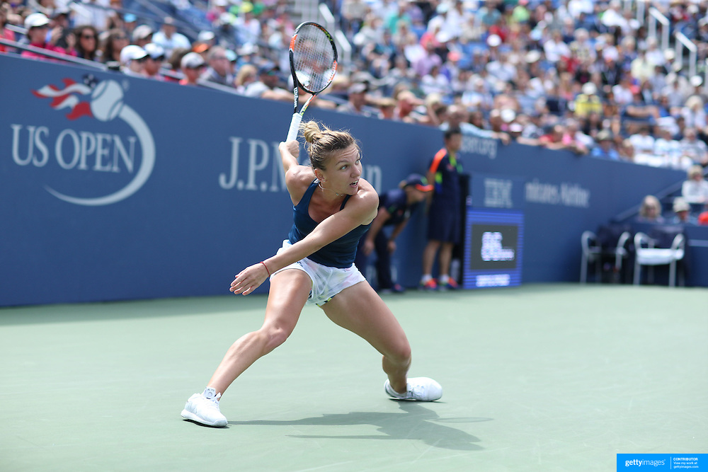 2016 U.S. Open - Day 8  Simona Halep of Romania in action against Carla Suárez Navarro of Spain in the Women's Singles round four match on Arthur Ashe Stadium on day six of the 2016 US Open Tennis Tournament at the USTA Billie Jean King National Tennis Center on September 5, 2016 in Flushing, Queens, New York City.  (Photo by Tim Clayton/Corbis via Getty Images)
