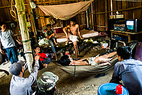 A group of men watching TV in a small village near Battambang, Cambodia.