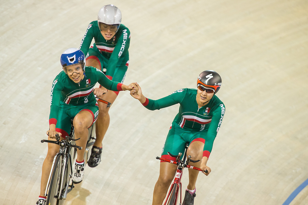 Mexico's team of (L-R) Sofia Arreola, Ingrid Drexel and Lizbeth Salazar celebrate their bronze medal win in the women's cycling team pursuit at the 2015 Pan American Games in Toronto, Canada, July 17,  2015.  AFP PHOTO/GEOFF ROBINS