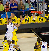 Jeff Withey (5) of the University of Kansas Jayhawks shoots the ball against the University of Michigan Wolverines during the NCAA South Regionals at Cowboys Stadium in Arlington on Friday, March 29, 2013. (Cooper Neill/The Dallas Morning News)