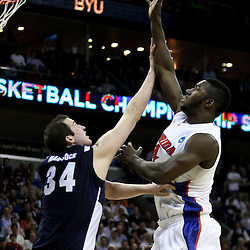 Mar 24, 2011; New Orleans, LA; Florida Gators forward/center Patric Young (4) shoots over Brigham Young Cougars forward Noah Hartsock (34) during the second half of the semifinals of the southeast regional of the 2011 NCAA men's basketball tournament at New Orleans Arena.  Mandatory Credit: Derick E. Hingle