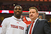 LUBBOCK, TX - MARCH 3: Head coach Chris Beard poses with Keenan Evans #12 of the Texas Tech Red Raiders during Senior Day activities before the game between the Texas Tech Red Raiders and the TCU Horned Frogs on March 3, 2018 at United Supermarket Arena in Lubbock, Texas. Texas Tech defeated TCU 79-75. Texas Tech defeated TCU 79-75. (Photo by John Weast/Getty Images) *** Local Caption *** Chris Beard;Keenan Evans