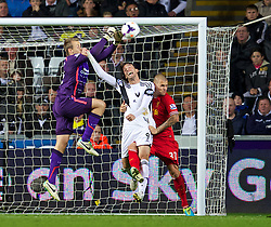 SWANSEA, WALES - Monday, September 16, 2013: Liverpool's goalkeeper Simon Mignolet and Martin Skrtel in action against Swansea City's Miguel Perez Cuesta 'Michu' during the Premiership match at the Liberty Stadium. (Pic by David Rawcliffe/Propaganda)