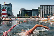 A close-up of a swimmer in Copenhagen harbor.