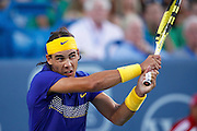 CINCINNATI, OH - AUGUST 20: Rafael Nadal of Spain returns a shot to Paul-Henri Mathieu of France during day four of the Western & Southern Financial Group Masters on August 20, 2009 at the Lindner Family Tennis Center in Cincinnati, Ohio. Nadal defeated Mathieu 7-5, 6-2. (Photo by Joe Robbins)