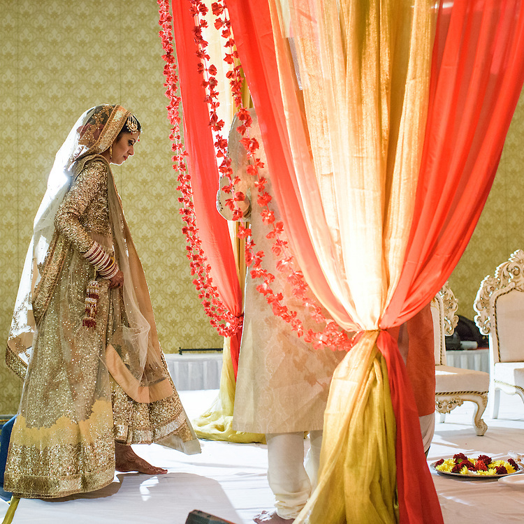 Baltimore, Maryland - December 20, 2014: Trisha Satya Pasricha ascends the mandap, a traditional Hindu wedding structure in one of Baltimore Marriott Waterfront Hotel's ballrooms. <br /> <br /> Trisha Satya Pasricha and Eshwan Ramudu married at the Baltimore Marriott Waterfront Hotel December 20, 2014. <br /> <br /> <br /> CREDIT: Matt Roth for The New York Times<br /> Assignment ID: 30168620A