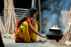 BANGLADESH SIRAJGANJ RADHUNIBARI 30JAN07 - Young Bangladeshi girl cooks spools of cotton yarn in a small pot of dye. Records of an indigenous weaving industry based on handlooms producing cotton fabrics date back to the 13th century in this area...jre/Photo by Jiri Rezac..© Jiri Rezac 2007..Contact: +44 (0) 7050 110 417.Mobile:  +44 (0) 7801 337 683.Office:  +44 (0) 20 8968 9635..Email:   jiri@jirirezac.com.Web:    www.jirirezac.com..© All images Jiri Rezac 2007 - All rights reserved.
