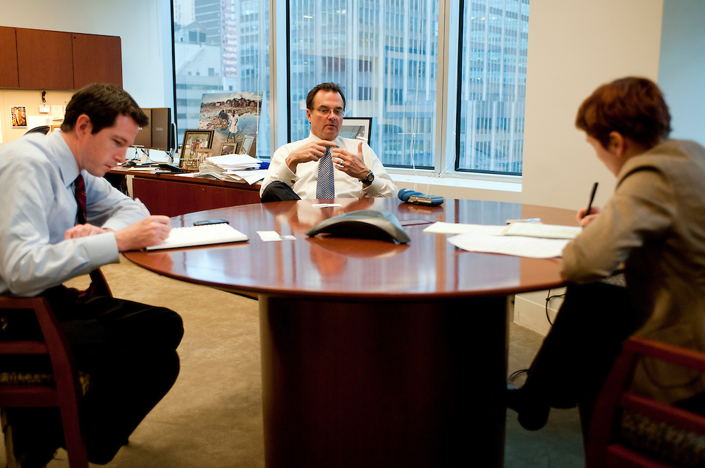 Craig S. Phillips, managing director at BlackRock solutions, in his office (middle). Left: director Brian Beades, right: Financial journalist Heike Buchter..BlackRock headquarters on 52nd street in Manhattan, New York City..Blackrock is the world's largest money managing company. According to Fortune magazine 'With more than $3 trillion in assets, Larry Fink and his team at BlackRock are the world's largest money managers'.