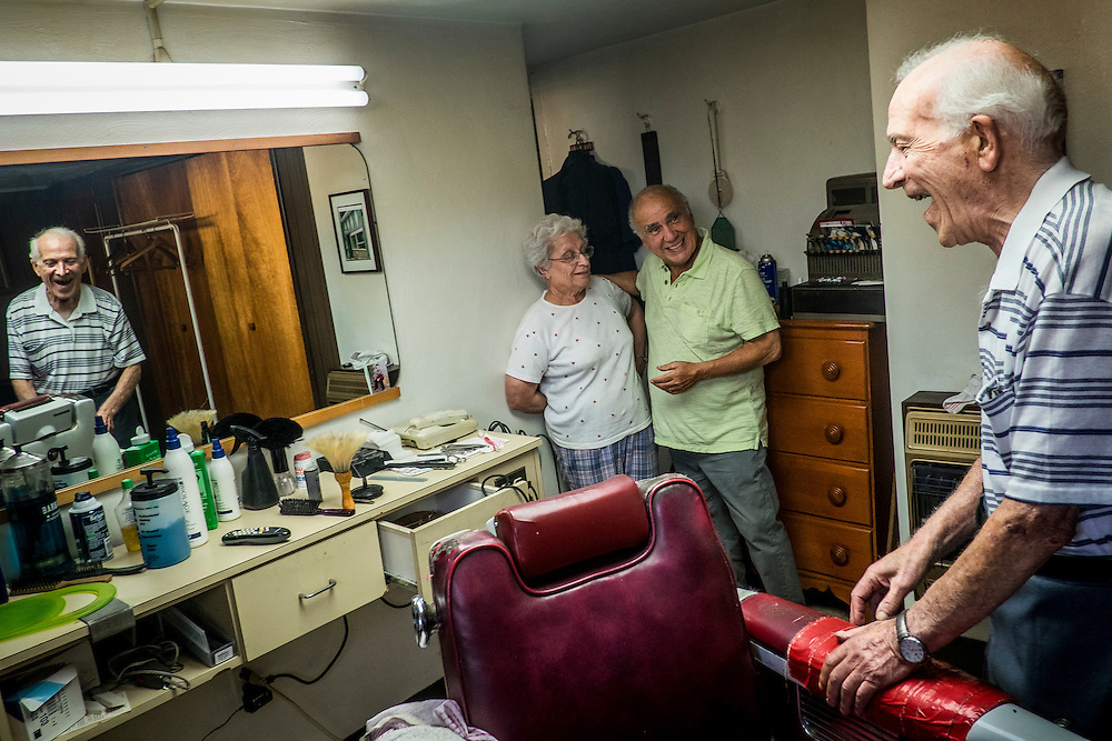 John Talarico looks on as his wife Margie talks with Monessen Mayor Lou Mavrakis in Tallarico&rsquo;s barber shop in the basement of his home in Monessen. Pa.<br />