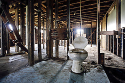 20 August 2015. New Orleans, Louisiana. <br /> Hurricane Katrina revisited. <br /> A decade later and recovery remains largely elusive for the area hardest hit by Katrina. A toilet is the only fixture remaining in an abandoned house flooded by in the storm a decade ago.<br /> Photo credit©; Charlie Varley/varleypix.com.