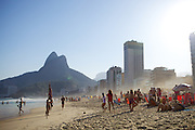 A beach scene with mountains, skyscrapers and the sea, Rio de Janeiro, Brazil.