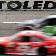 SPT Menards21<br /> <br /> Two cars drive past the &quot;Toledo Speedway&quot; sign during the Menards 200 ARCA race at Toledo Speedway in Toledo on Sunday, May 20, 2018. THE BLADE/KURT STEISS