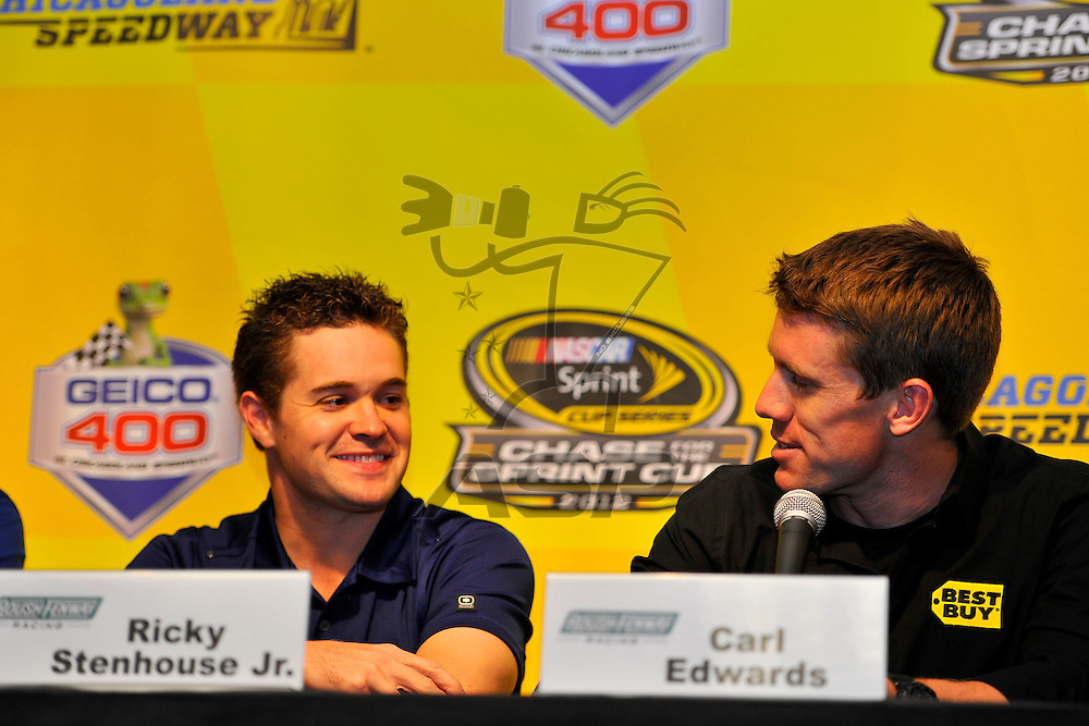 Joliet, IL - SEP 14, 2012:  Ricky Stenhouse, Jr. is announced as driver of the Roush Fenway Best Buy Ford for 2013 as Carl Edwards talks about being a teammate before the practice for the Geico 400 at the Chicagoland Speedway in Joliet, IL.