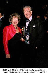 MR & MRS BOB HOLNESS, he is the TV presenter, at a party in London on February 22nd 1997.LWP 11