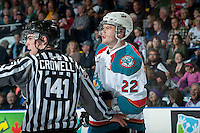 KELOWNA, CANADA - MARCH 27: Chance Braid #22 of Kelowna Rockets trash talks a player of the Tri-City Americans after linesman Kevin Crowell stepped between them on March 27, 2015 at Prospera Place in Kelowna, British Columbia, Canada.  (Photo by Marissa Baecker/Shoot the Breeze)  *** Local Caption *** Chance Braid; Kevin Crowell;