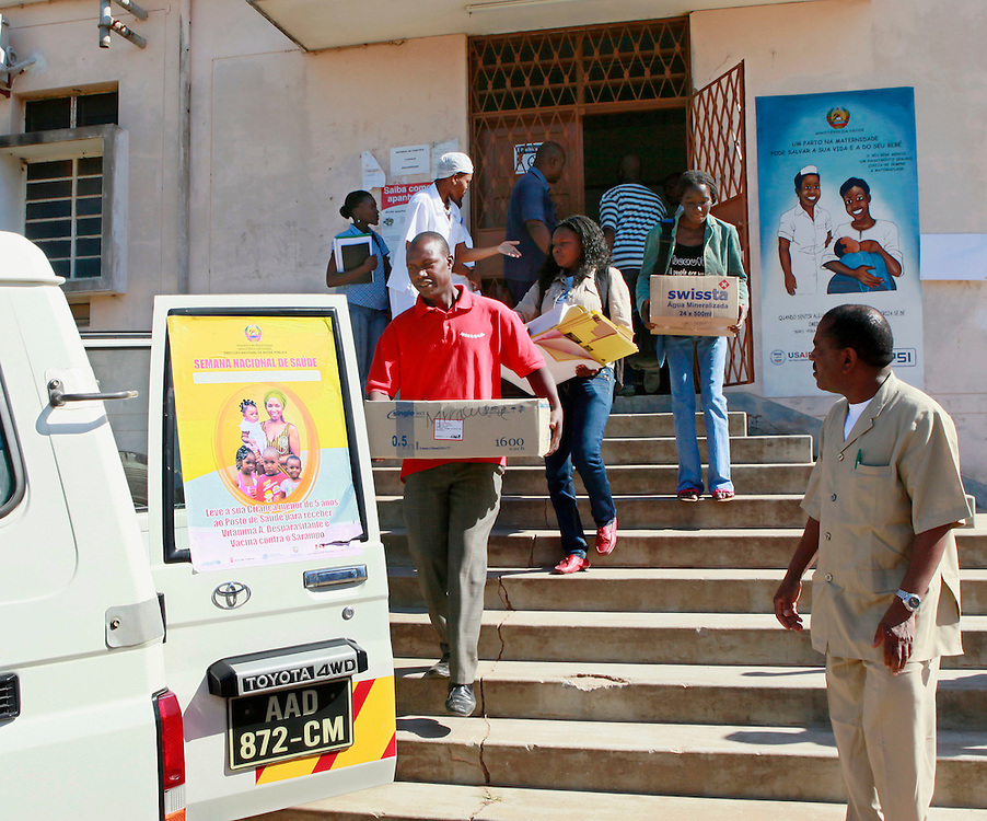 Local health workers in the district of Marracuene load a vehicle with supplies to be used for the national measles campaign starting tomorrow in Mozambique, Sunday, May 22, 2011. The campaign aims to vaccinate 3.6 million children under the age of 5, over a 5 day period, with the ultimate goal of eliminating the disease from the country.(Stuart Ramson for United Nations Foundation)