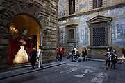 Women admire wedding dress in window of Atelier Aimee bridal shop on Florence's Borgo degli Albizi..