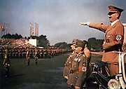 Adolf Hitler (1889–1945) Austrian-born German politician, leader of the Nazi Party.  Chancellor of Germany (1933–1945) and Führer und Reichskanzler of Germany (1934–1945).  Hitler taking the salute at a Nazi rally.