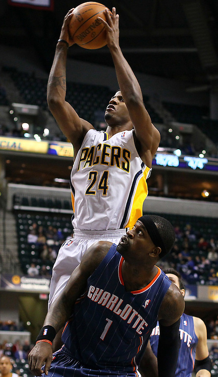 Feb. 09, 2011; Indianapolis, IN, USA; Indiana Pacers forward Paul George (24) puts up a shot over Charlotte Bobcats shooting guard Stephen Jackson (1) at Conseco Fieldhouse. Mandatory credit: Michael Hickey-US PRESSWIRE