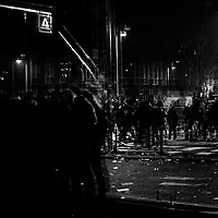 People celebrate in the streets of Amsterdam New Year's Eve and sending up rockets.
