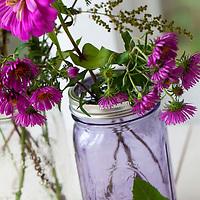Arranging flower bouquets in mason jars
