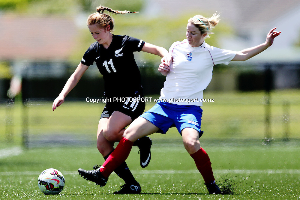 Emily Oosterhof of NZF Development competes against Melaine Gooch of Auckland Football. 2014 ASB Women's League football match, Auckland Football v NZF Development at William Green Domain, Auckland, New Zealand. Sunday 23 November 2014. Photo: Anthony Au-Yeung / photosport.co.nz