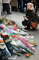 A mourner  leaves  flowers outside  South Africa House in London, Friday, 6th December 2013, following the death Nelson Mandela, Picture by Stephen Lock / i-Images