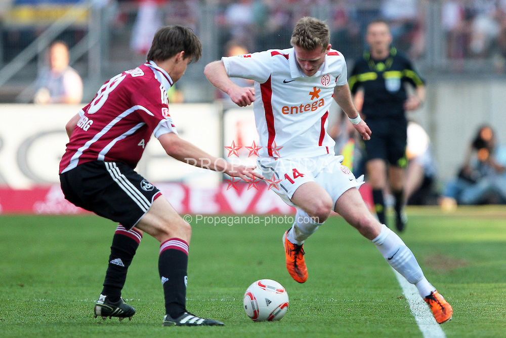 24.04.2011, easy Credit Stadion, Nuernberg, GER, 1.FBL, 1. FC Nuernberg / Nürnberg vs 1. FSV Mainz 05, im Bild:.Philipp Wollscheid (Nuernberg #38) gg Andre Schürrle / Schuerrle (Mainz #14).EXPA Pictures © 2011, PhotoCredit: EXPA/ nph/  Will       ****** out of GER / SWE / CRO  / BEL ******
