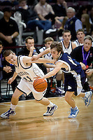 JEROME A. POLLOS/Press..Lake City's T.J. Philp steals the ball from Josh Phillips from Rocky Mountain High during the second half of their game Friday at the state 5A boys basketball tournament at Idaho Center in Nampa. The T-Wolves were eliminated from the tournament after the 72-52 loss to the Grizzlies.