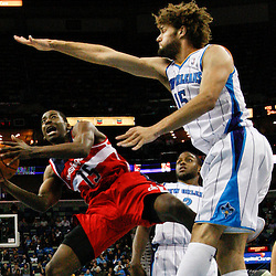 Dec 11, 2012; New Orleans, LA, USA; Washington Wizards shooting guard Jordan Crawford (15) shoots over New Orleans Hornets center Robin Lopez (15) during the second quarter of a game at the New Orleans Arena.  Mandatory Credit: Derick E. Hingle-USA TODAY Sports