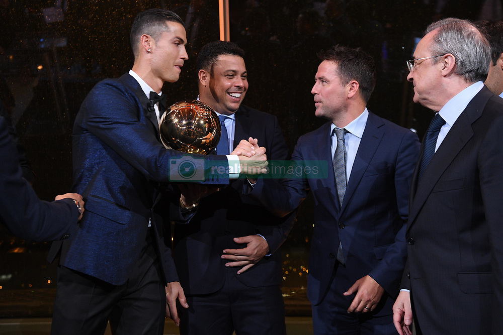7 December 2017 -  Ballon d'Or 2017 - Cristiano Ronaldo holds the Ballon d'Or trophy as he is congratulated by Ronaldo Luís Nazario, Michael Owen and Real Madrid President Florentino Perez - Photo: Presse Sports / Offside