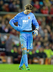 LIVERPOOL, ENGLAND - Thursday, February 25, 2016: FC Augsburg's goalkeeper Marwin Hitz looks dejected as his side lose 1-0 to Liverpool during the UEFA Europa League Round of 32 1st Leg match at Anfield. (Pic by David Rawcliffe/Propaganda)