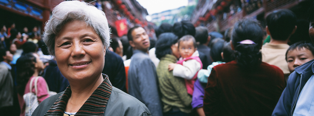 Woman during Festival in Old Stone Street. Duyun, Guizhou Province, China.