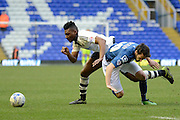 Fulham midfielder Rohan Ince tackles and fouls Birmingham City midfielder Will Buckley  during the Sky Bet Championship match between Birmingham City and Fulham at St Andrews, Birmingham, England on 19 March 2016. Photo by Alan Franklin.