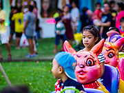24 NOVEMBER 2018 - BANGKOK, THAILAND:  Children ride a toy train on the midway at the Red Cross Fair. The Red Cross Fair is a fund raiser and an annual event in Bangkok that draws thousands of attendees every night of its nine day run. The fair features games of chance, a midway with rides, handicrafts and food. This is the first year the fair has been in Lumpini Park. Previously it had been held in the Dusit section of Bangkok. The 2018 Fair marks 125 years of service for the Red Cross in Thailand.    PHOTO BY JACK KURTZ