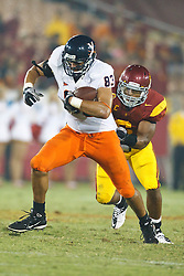 September 11, 2010; Los Angeles, CA, USA;  Virginia Cavaliers tight end Joe Torchia (83) rushes up field past Southern California Trojans linebacker Malcolm Smith (6) during the fourth quarter at the Los Angeles Memorial Coliseum. USC defeated Virginia 17-14.