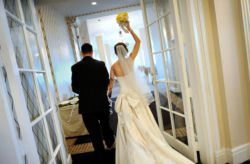 A bride and groom at the Berkeley Oceanfront Hotel along the boardwalk in  Asbury Park, New Jersey.