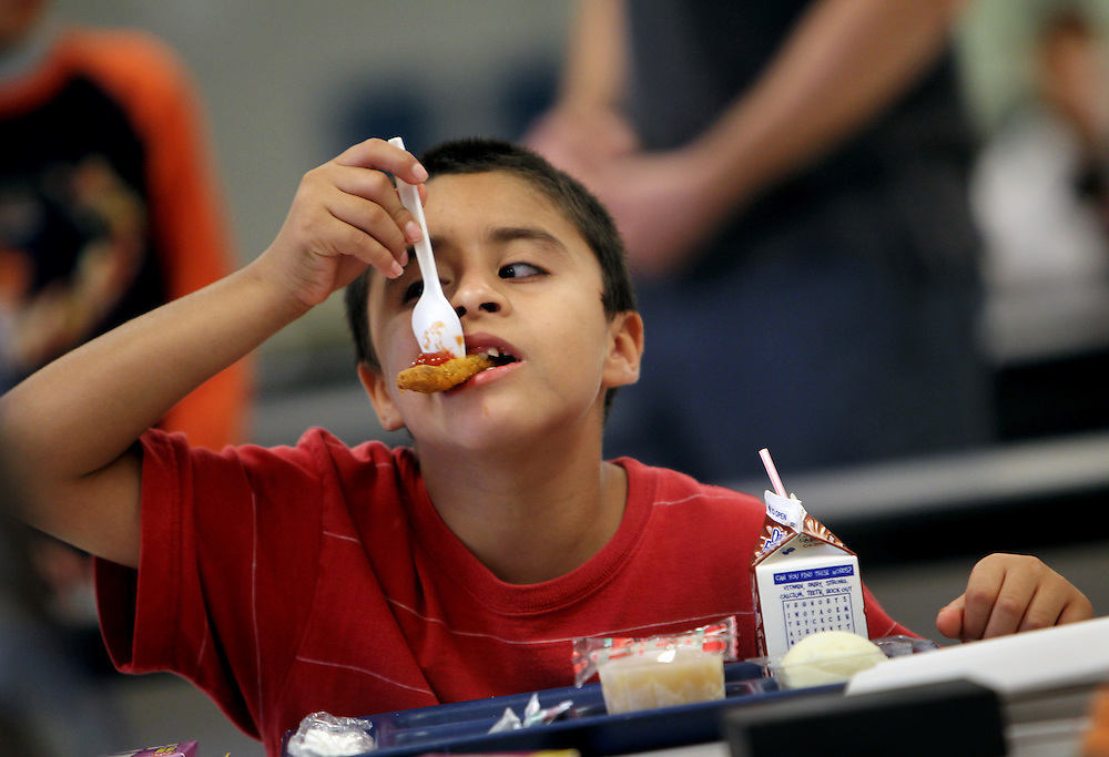 Bryan Albarran, who will be in 4th grade this fall, eats a free lunch with classmates on the last day of a summer school program at John R. Good Elementary School in Irving July 1, 2010. The rate of children from low income families enrolled in Irving schools is now at 80%, very close to Dallas schools. (Courtney Perry/The Dallas Morning News) .07182010xMETRO
