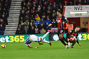 Abdelhamid Sabiri (29) of Huddersfield Town and Lewis Cook (16) of AFC Bournemouth clash during the Premier League match between Bournemouth and Huddersfield Town at the Vitality Stadium, Bournemouth, England on 4 December 2018.