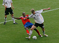 Photo: Glyn Thomas.<br />Germany v Costa Rica. Group A, FIFA World Cup 2006. 09/06/2006.<br /> Germany's Tim Borowski (R) battles for the ball with Paulo Wanchope.