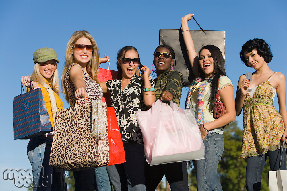 Young women with shopping bags outdoors (portrait)