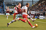 Charlton Athletic Midfielder, Chris Solly looks to pass the ball past Burnley Midfielder, Scott Arfield during the Sky Bet Championship match between Burnley and Charlton Athletic at Turf Moor, Burnley, England on 19 December 2015. Photo by Mark Pollitt.