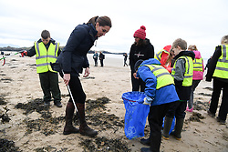 The Duchess of Cambridge joins primary school pupils in a beach clean-up during a visit to Newborough Beach in North Wales.
