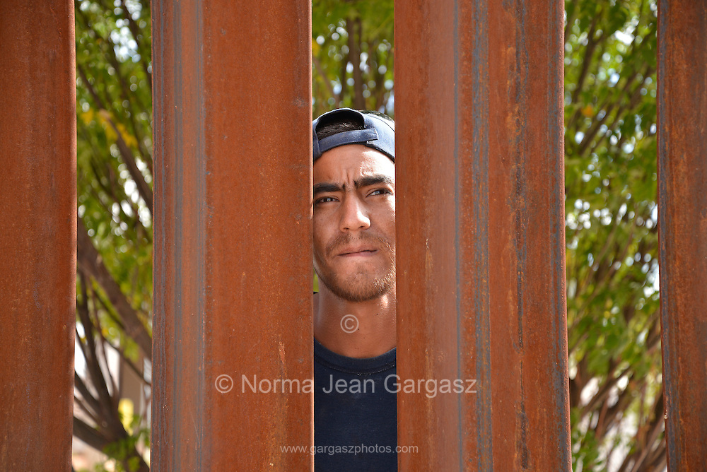 "A man in Agua Prieta, Sonora, Mexico, who identified himself as, ""Jesus"", looks through the boder wall in to Douglas Arizona, USA."