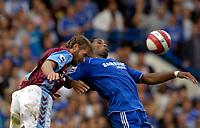 Photo: Daniel Hambury.<br />Chelsea v Aston Villa. The Barclays Premiership. 30/09/2006.<br />Chelsea's Didier Drogba and Villa's Olof Mellberg battle for the ball.